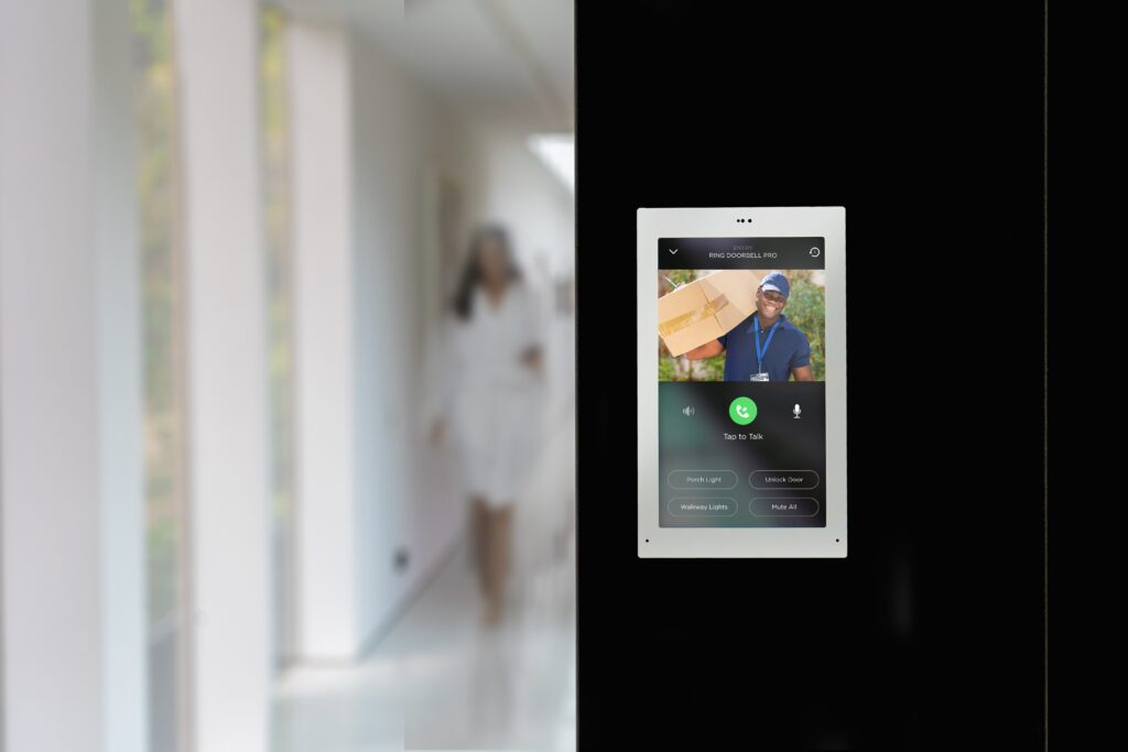 Savant Touch Panel Hallway with Delivery Guy